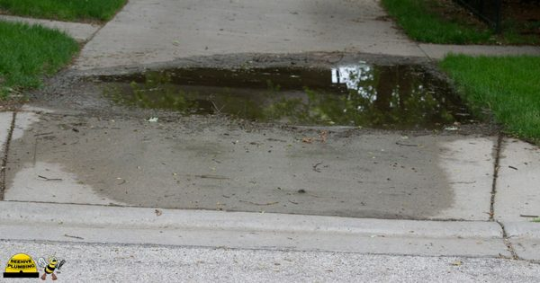 water on sidewalk due to leaky water main
