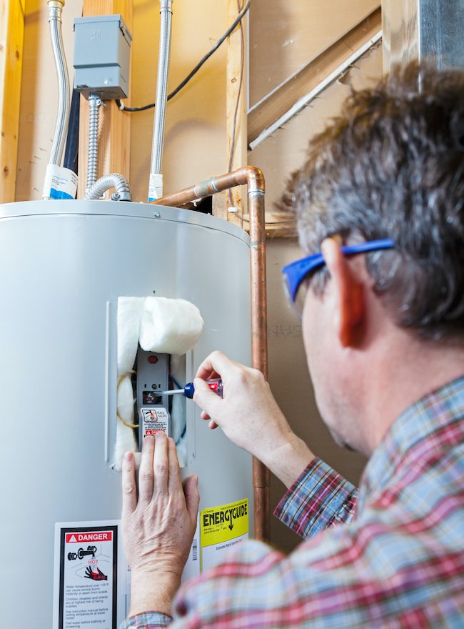 A technician performing water heater repair
