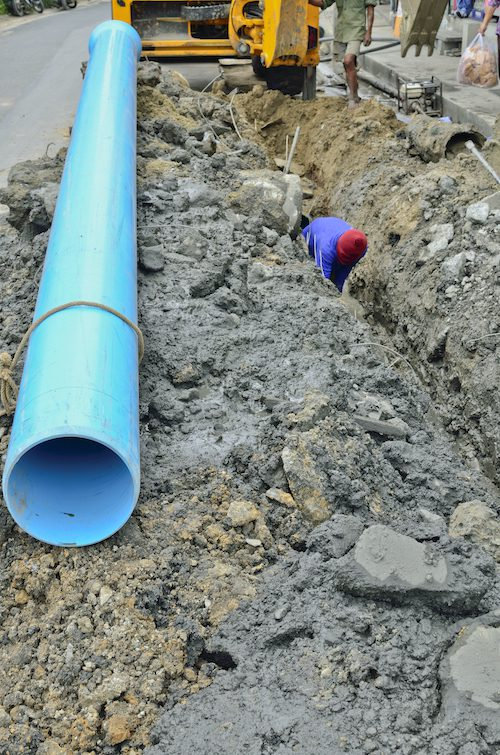 man digging trench for water supply