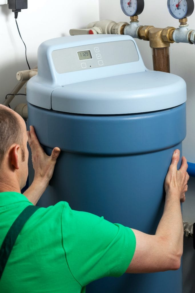 Water Softener Installation in a basement room helping a residential plumbing system